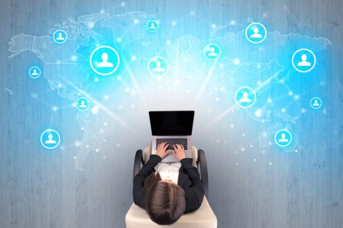 Social media concept with woman sitting on chair with tablet on her hand